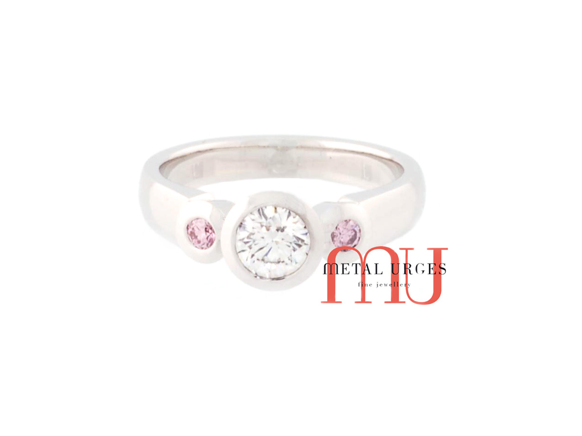 Rare pink and white diamond engagement ring in 18ct white gold. Custom made in Australia.