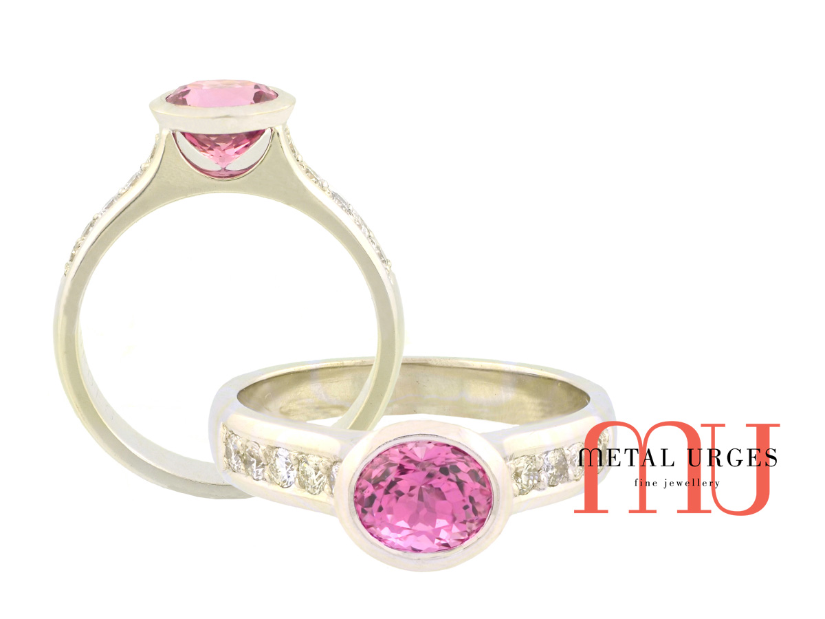 Pink sapphire and round white diamond engagement ring in 18ct white gold. Custom made in Australia.