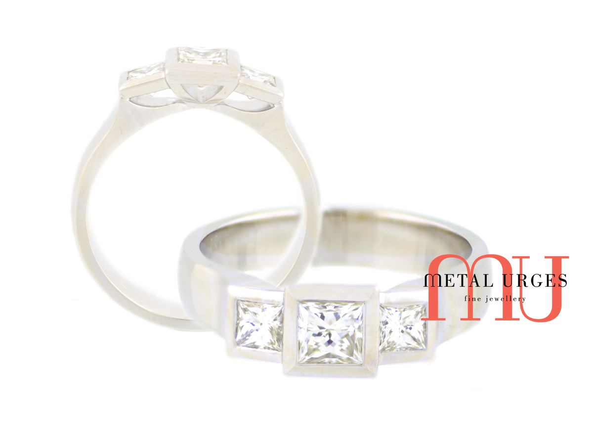 Three square princess cut white diamond and platinum engagement ring.  Custom made in Hobart.