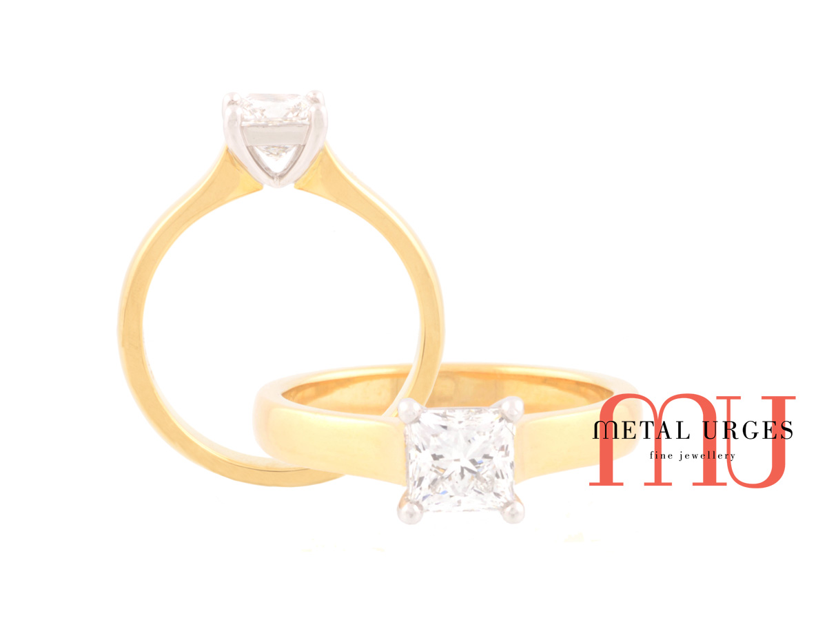 Princess cut white diamond and 18ct yellow gold engagement ring.
