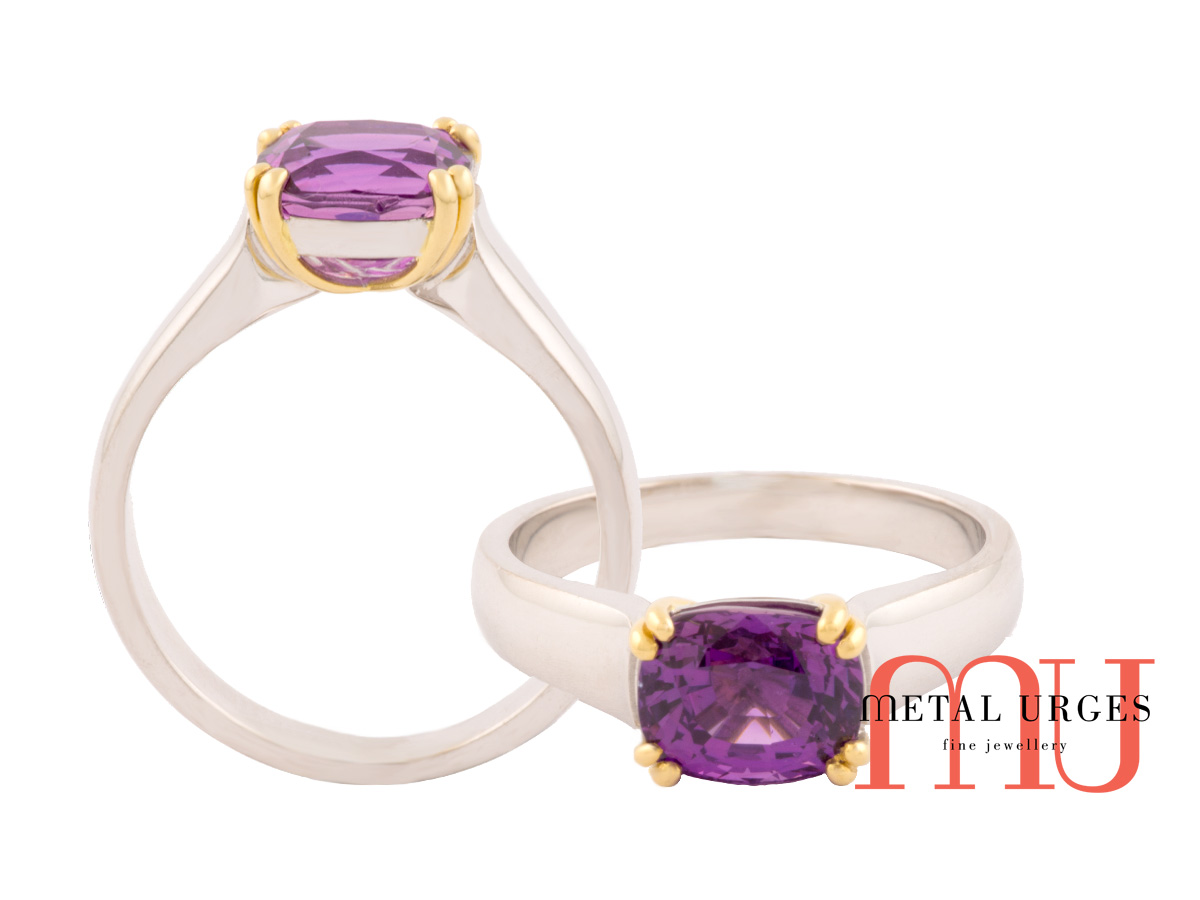 Cushion cut purple sapphire set with 18ct yellow gold and white gold band