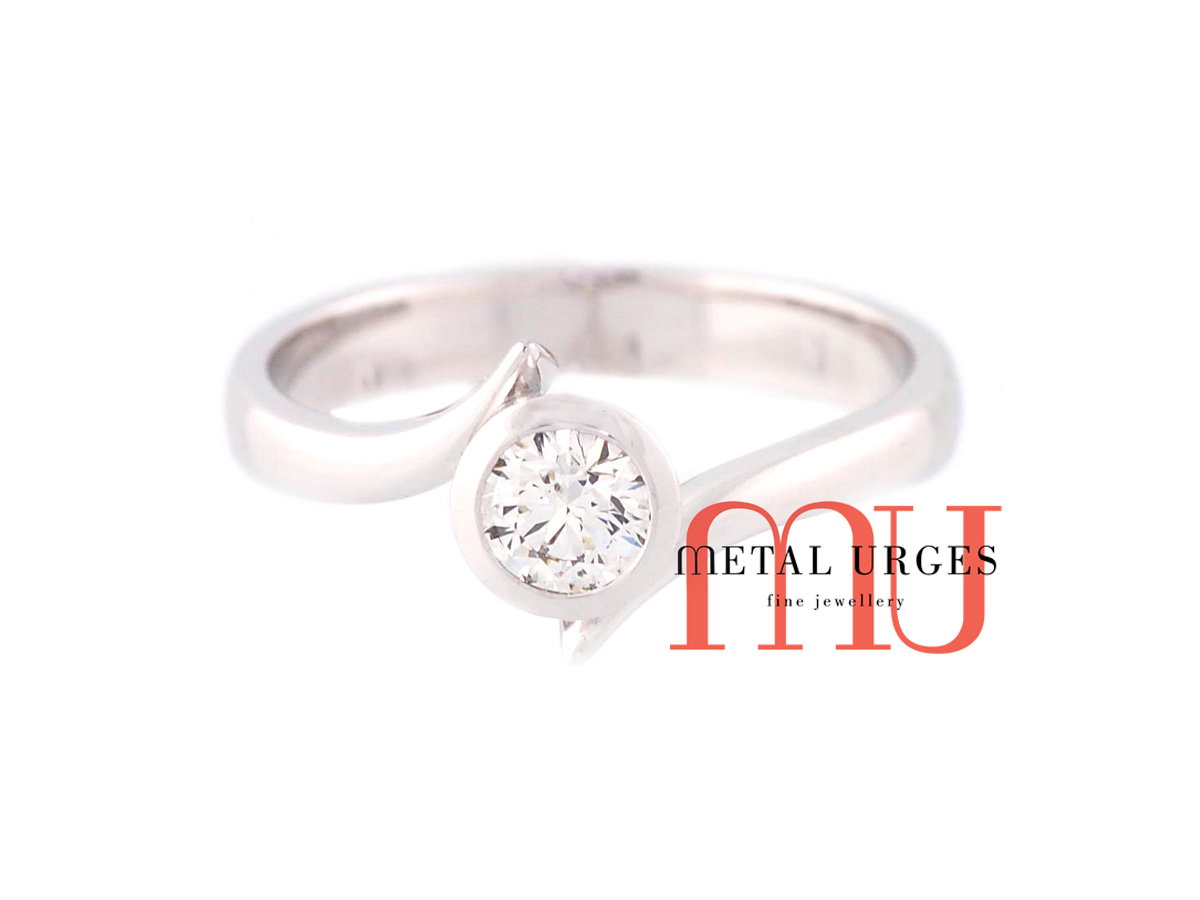 Brilliant cut white diamond and 18ct white gold solitaire engagement ring. Custom made in Australia.