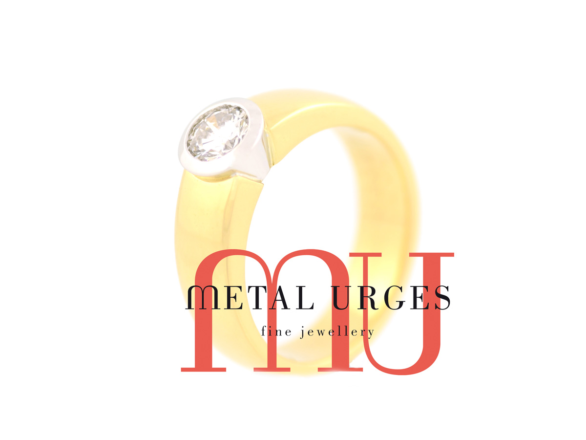 Round brilliant cut white diamond engagement ring in 18ct white and yellow gold. Custom made in Australia.
