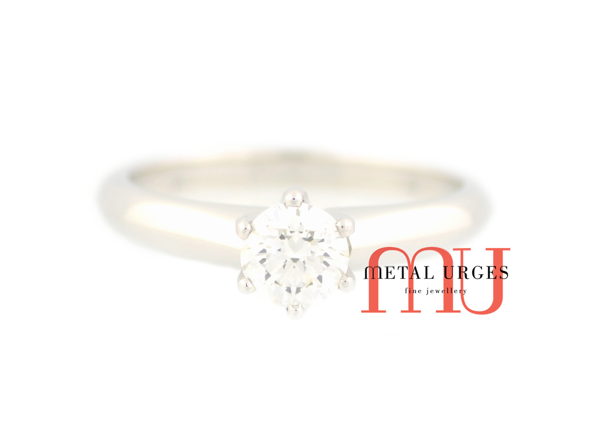 Tiffany's inspired solitaire brilliant cut white diamond engagement ring in 18ct white gold.  Custom made in Australia.