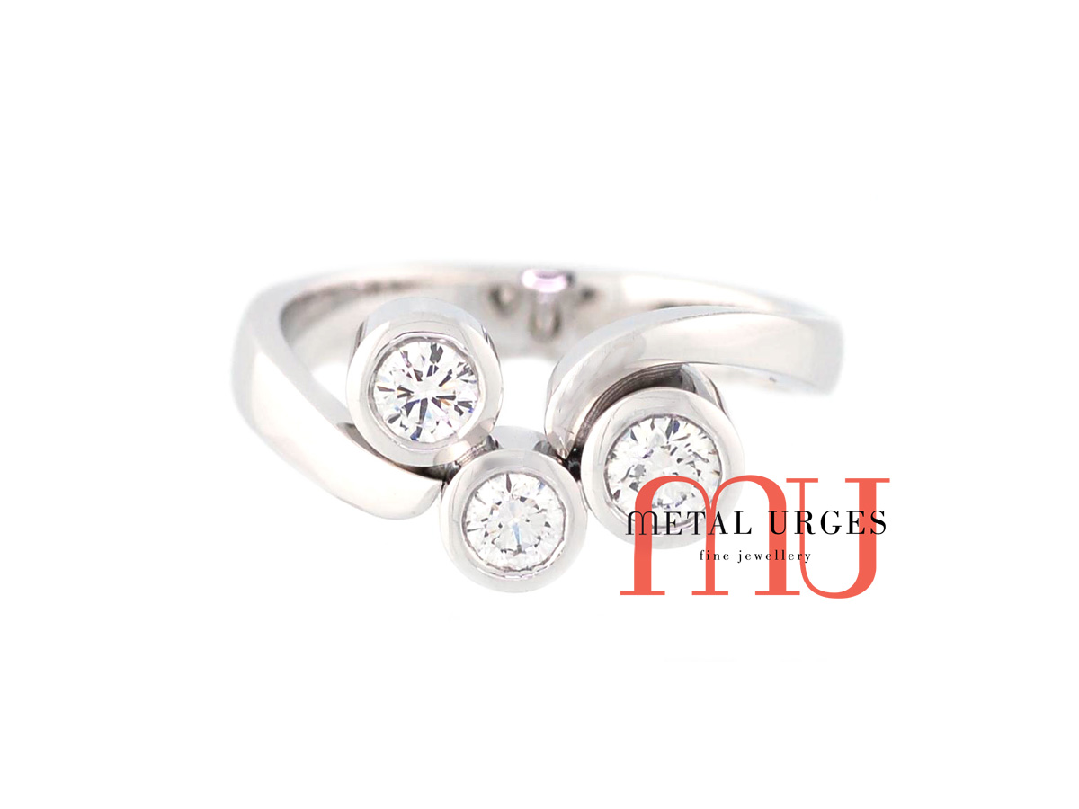 Three stone engagement, anniversary or dress ring.  Round brilliant cut white diamonds bezel set in 18ct white gold.  Custom made in Hobart.