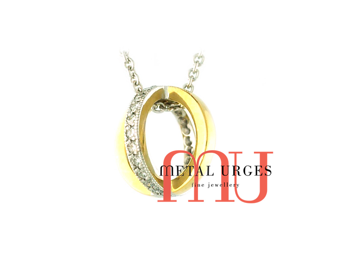 White diamond set orbit pendant necklace in 18ct white and yellow gold. Custom made in Australia.