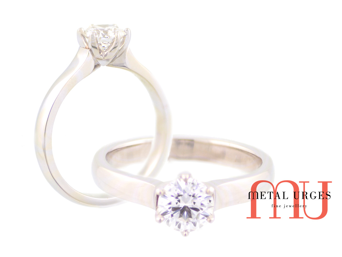 Tiffany inspired classic six claw 18ct white gold and natural round brilliant cut GIA certified white diamond engagement ring.  Custom made in Hobart.
