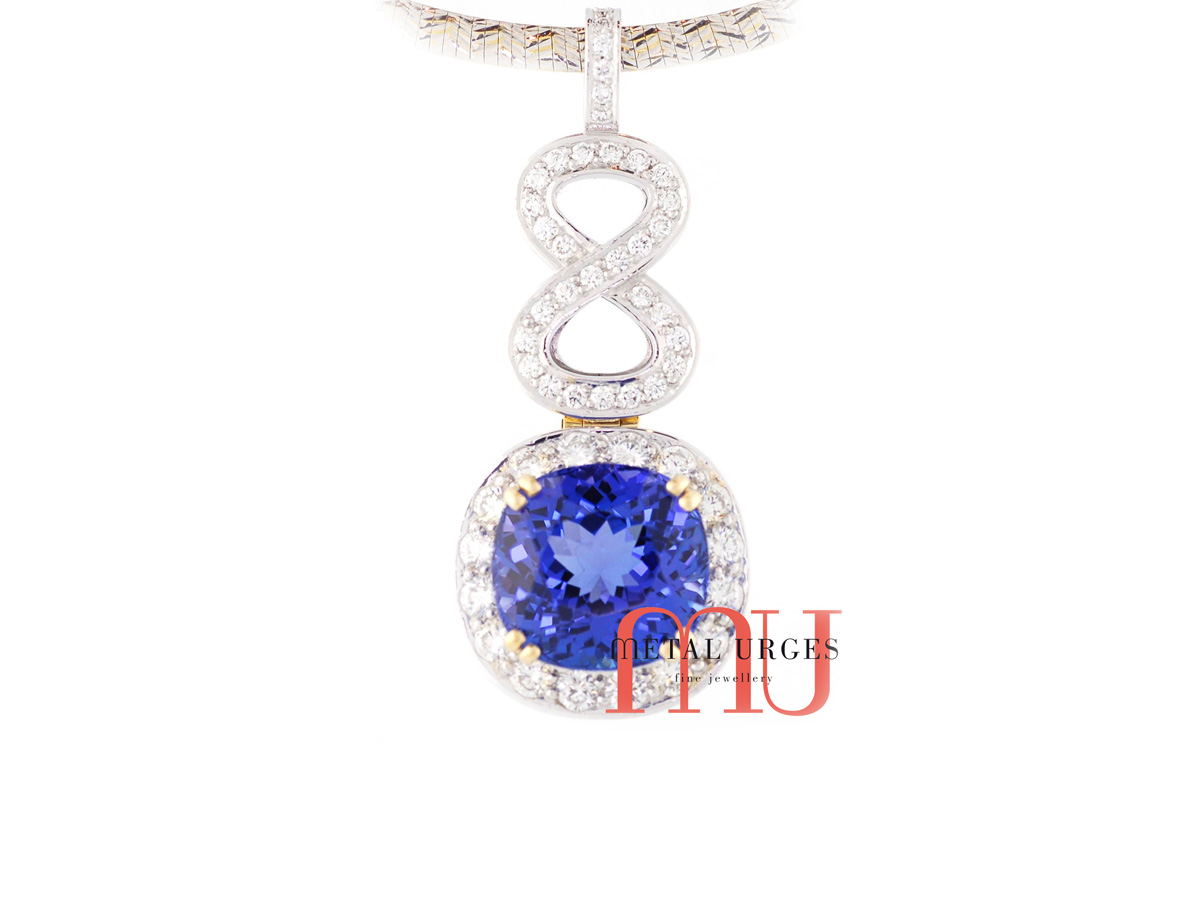 Natural blue sapphire and diamond pendant in 18ct white gold. Custom made in Australia.