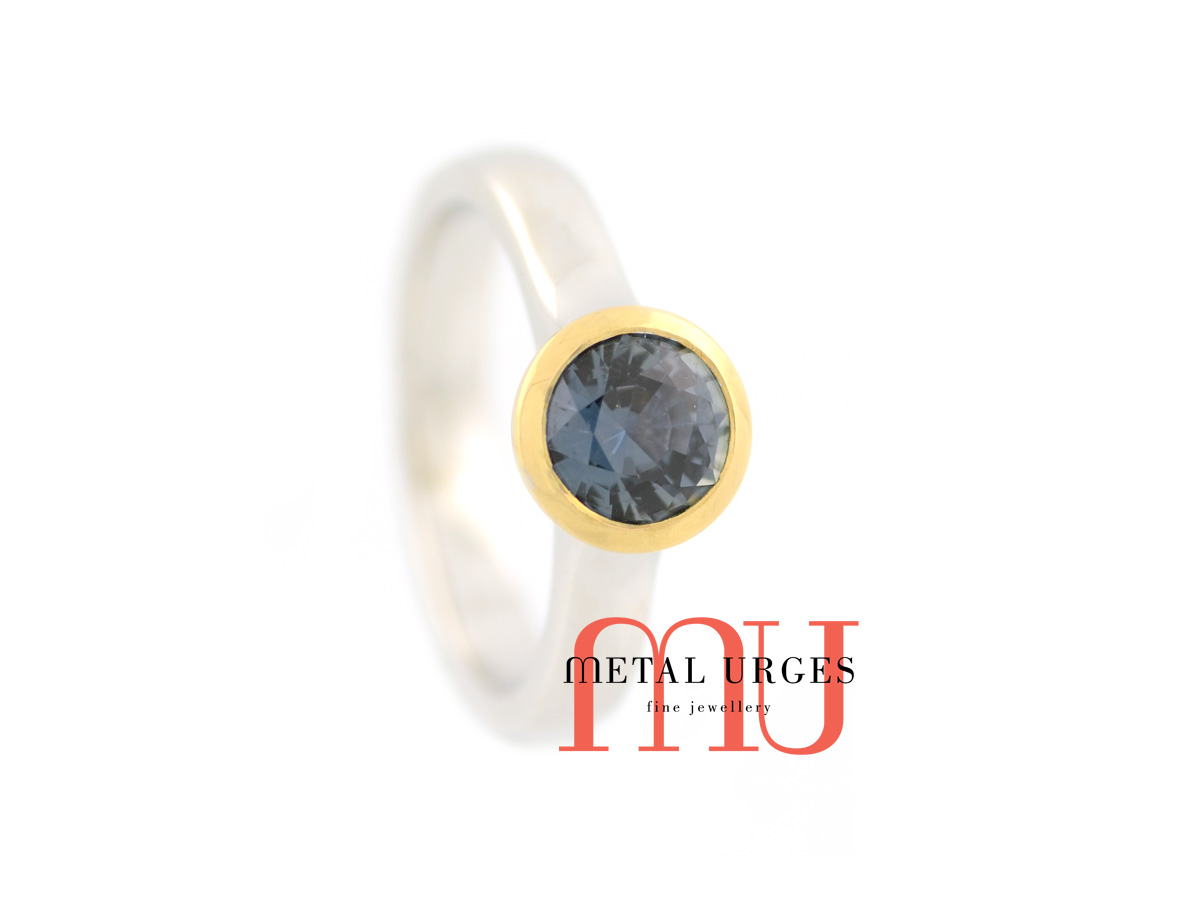 Blue green round sapphire engagement ring in 18ct white and yellow gold. Custom made in Australia.