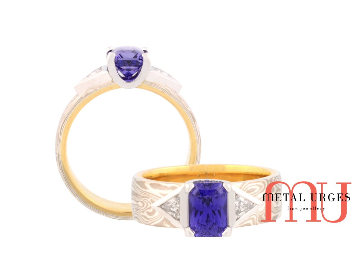 Vibrant blue sapphire and diamond engagement ring in 18ct yellow gold, white gold and silver mokume gane. Custom made in Australia.