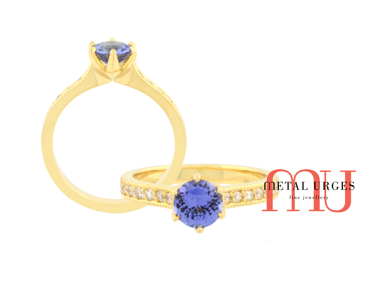 Vibrant blue sapphire and white diamond engagement ring in 18ct yellow gold. Handmade by our Jewellers, in Hobart Tasmania.