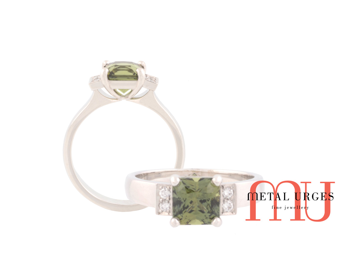 Green sapphire and white diamond engagement ring in platinum. Custom made in Australia.