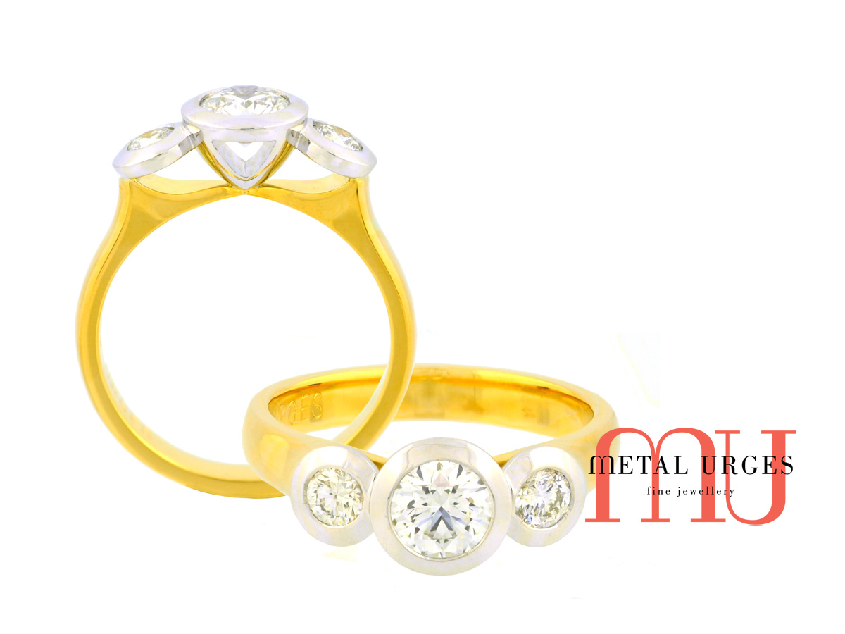 Three stone engagement ring.  GIA certified round brilliant cut white diamonds set in platinum with an 18ct yellow gold band.  Hand made in Hobart, Tasmania.