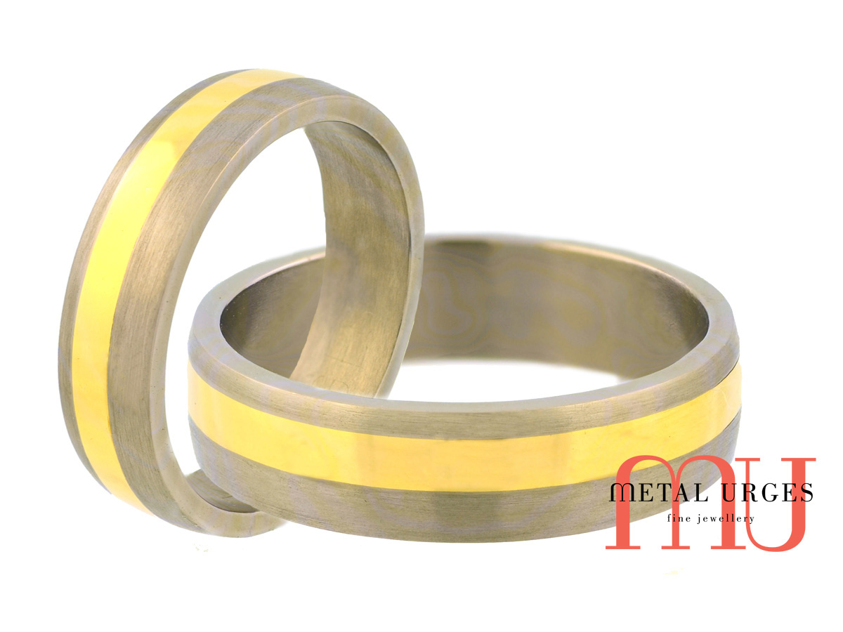 Directionally brushed matt finish titanium and 18ct yellow wedding ring. Custom made in Australia.