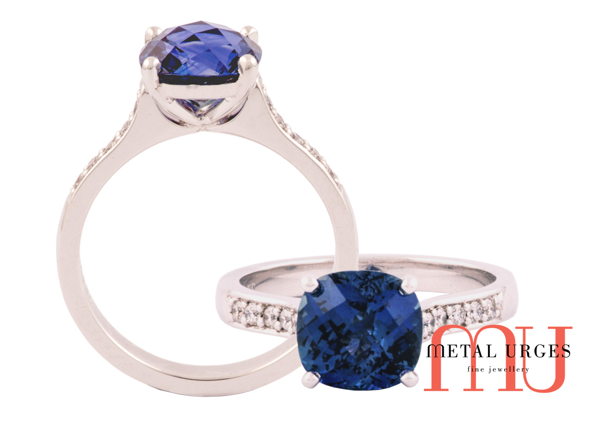 Unique cut blue sapphire and grain set white diamond ring