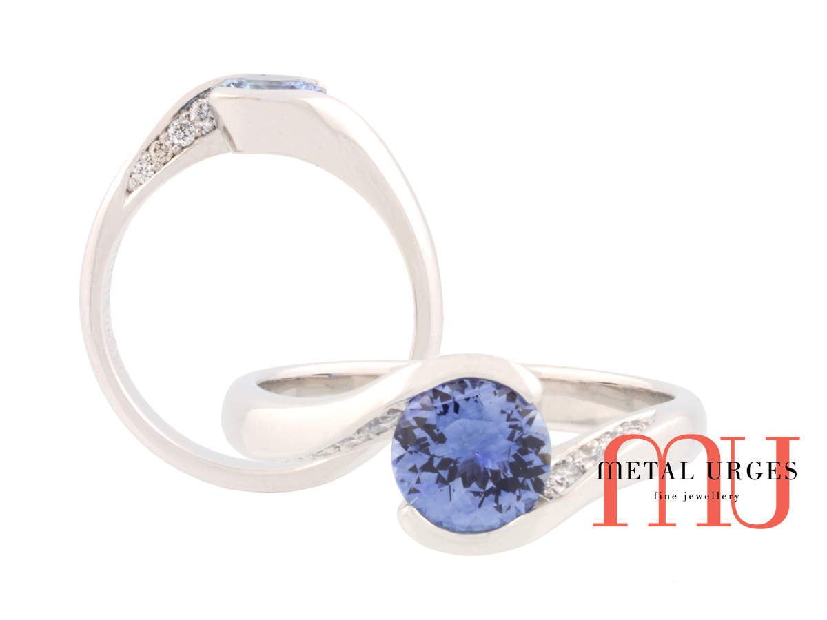 Unique vibrant blue sapphire, white diamond and gold engagement ring. Custom made in Australia.