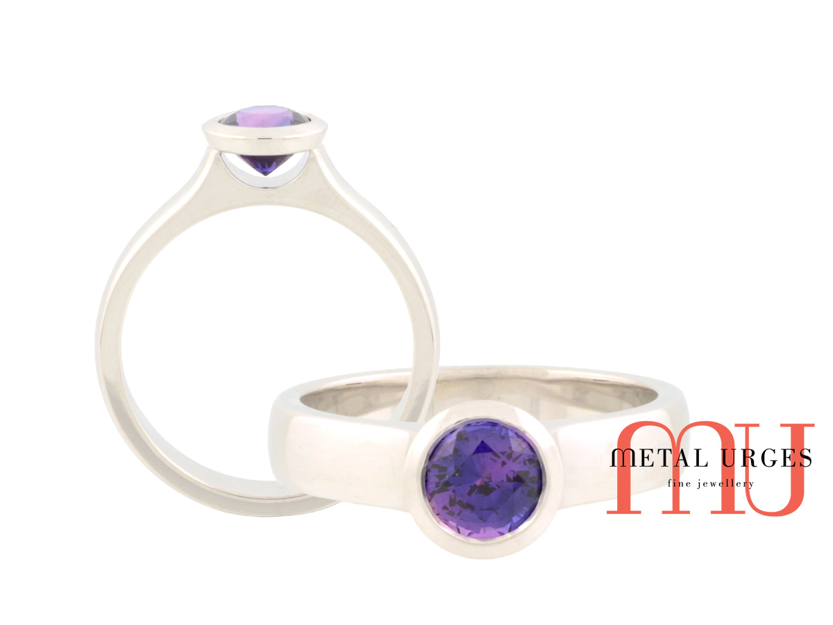 Purple sapphire and platinum engagement ring. Custom made in Australia.
