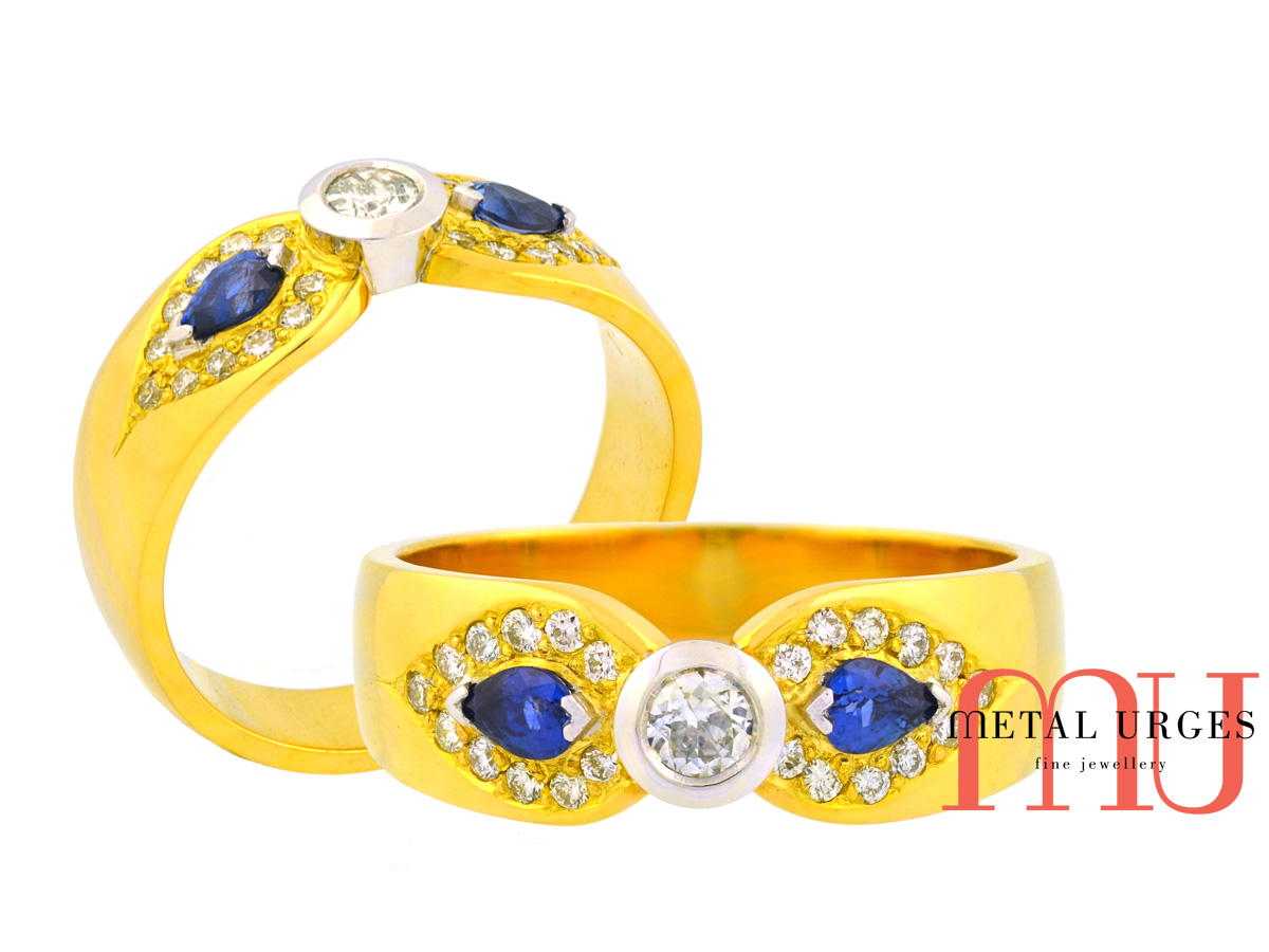 Designer dress ring featuring natural round white diamond with a matched pear shaped Sri Lankan blue sapphires in 18ct yellow and white gold.  Custom made in Hobart.