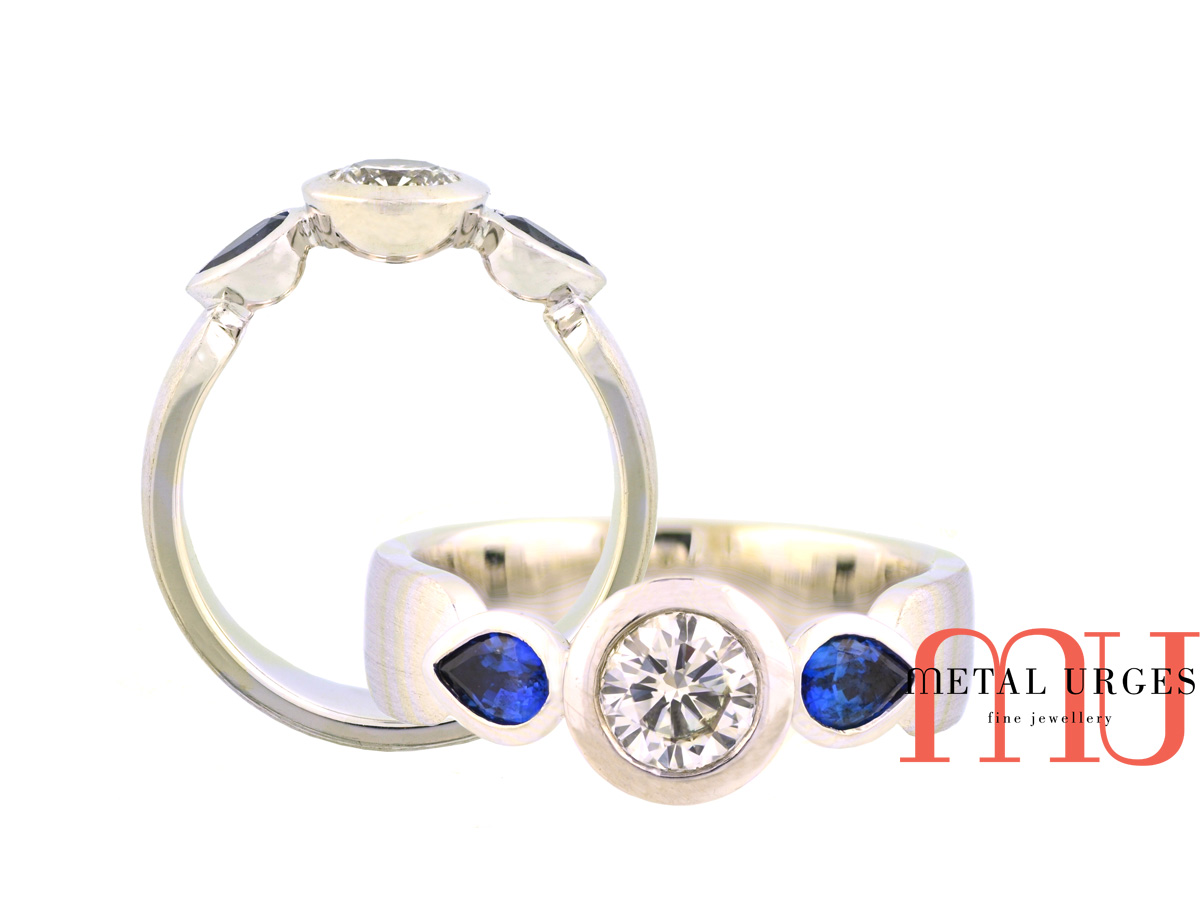 Natural round brilliant cut GIA certified white diamond and Sri Lankan blue pear shaped sapphire engagement ring in 18ct white gold.  Made in Australia.