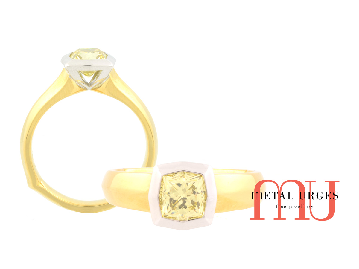 Unique canary diamond ring in 18ct white and yellow gold. Custom made in Australia.