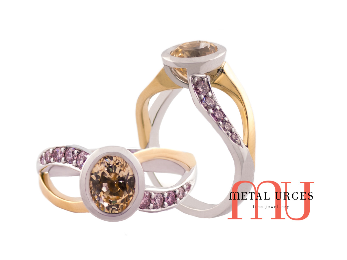 Bezel set yellow sapphire with pink diamonds in yellow gold and white gold band.