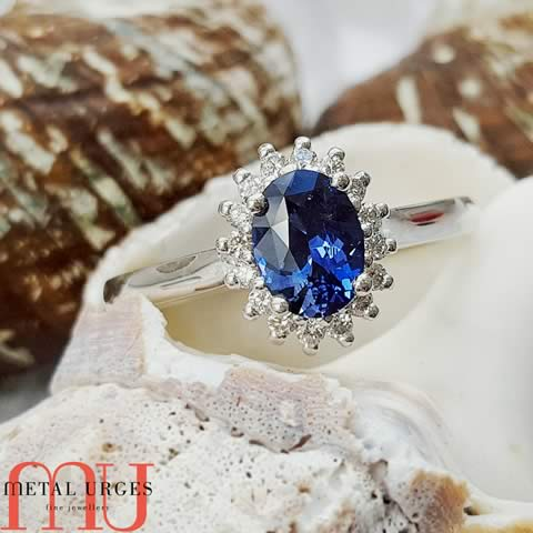YouTube – Antique style natural deep blue oval sapphire and diamond engagement ring
