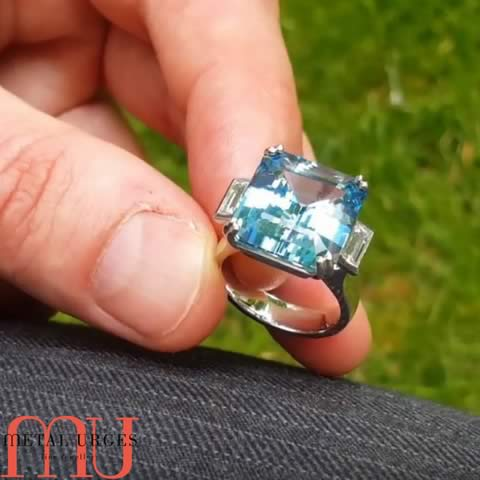 YouTube – Aquamarine squarish step-cut and diamond platinum engagement ring